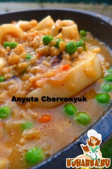 Рецепт Кальмары с овощами и рисом.