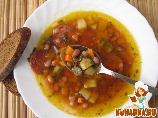 Рецепт Томатный суп с салями, фасолью и чечевицей.
